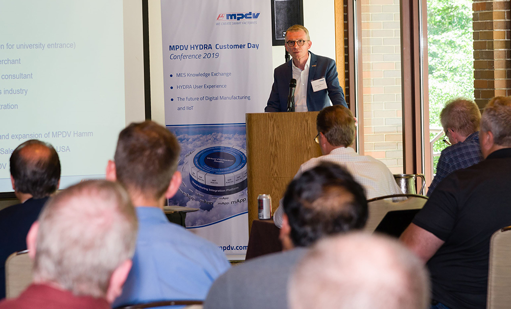 MPDV's Vice President of Sales Juergen Petzel delivers his keynote address at the MPDV USA Customer Day & Industrial IoT Forum 2019. (Image source: MPDV)